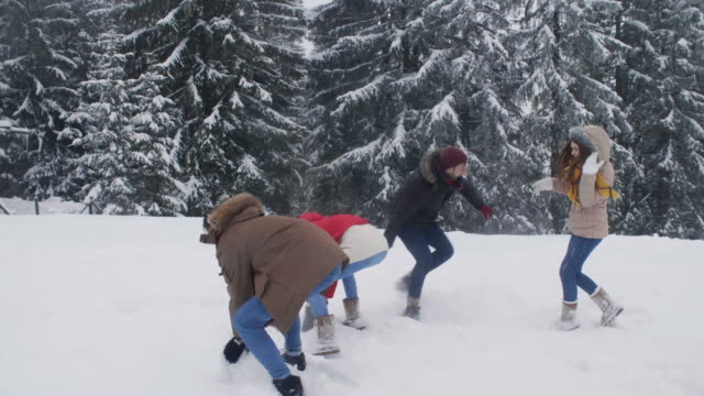 Young couple during snowball fight
