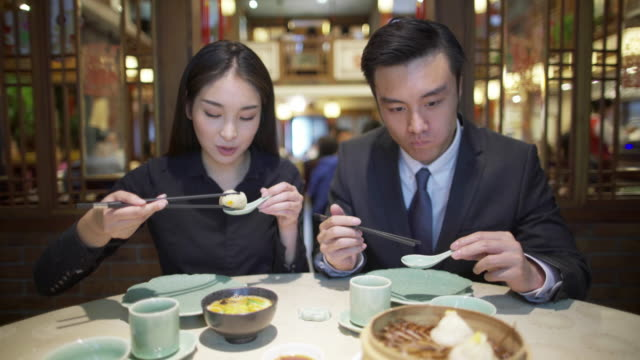 MS young couple eating in a restaurant, Shanghai, China
