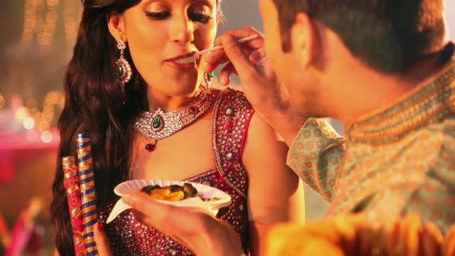 young couple eating tikki in dandia festival, delhi, india - spoon stock videos and b-roll footage