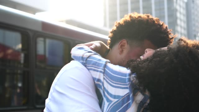 young couple embracing at city - pardo brazilian stock videos & royalty-free footage