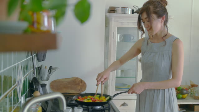 young couple enjoy cooking at home. - domestic kitchen stock videos & royalty-free footage