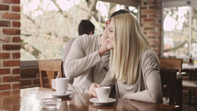 young couple enjoying a cup of coffee - image stock videos & royalty-free footage