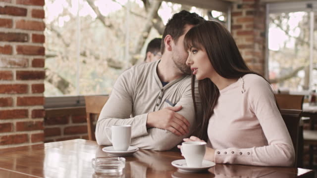 young couple enjoying a cup of coffee - hoozone stock videos and b-roll footage