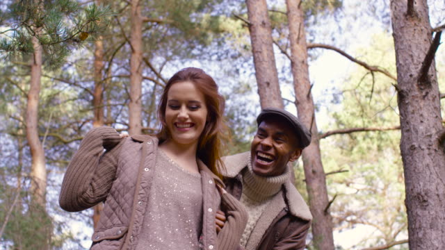 A young couple enjoying a forest walk in Autumn