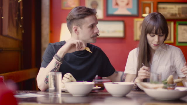 A young couple enjoying a meal together in a coffee shop in Manchester