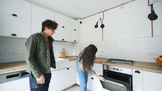 young couple enjoying a new place to live in. - examining stock videos and b-roll footage