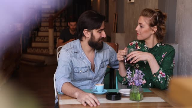 young couple enjoying at the coffee shop - dating stock videos & royalty-free footage