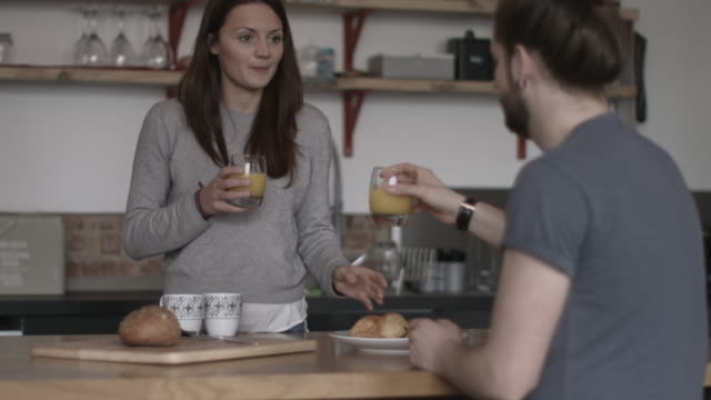 young couple enjoying breakfast together - juice drink stock videos & royalty-free footage