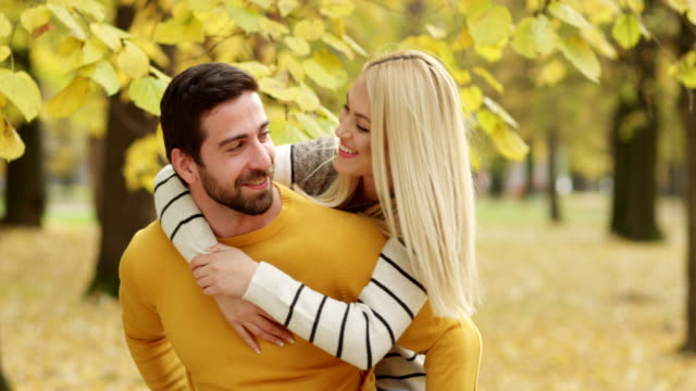 Young couple enjoying in park in autumn