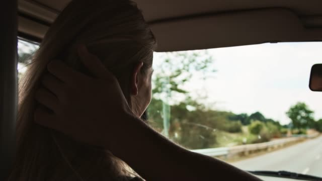 young couple enjoying road trip during summer - vehicle interior stock videos & royalty-free footage