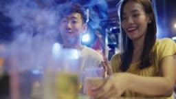Young couple enjoying street food
