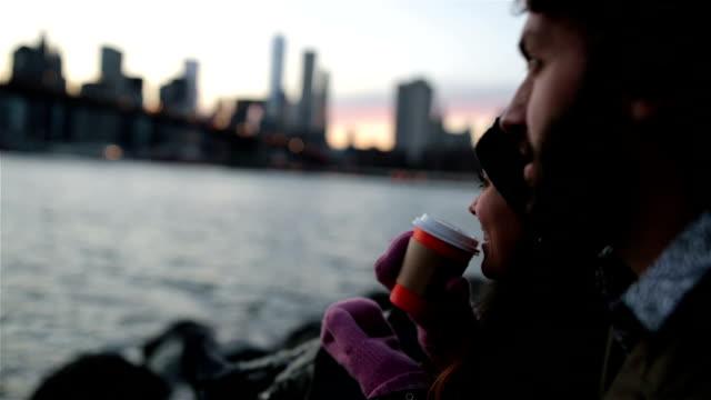 Young Couple Enjoying Sunset at Brooklyn Bridge, NYC