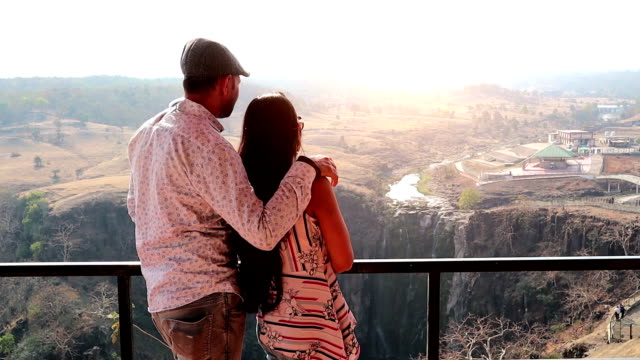 young couple enjoying view from balcony - youth culture stock videos & royalty-free footage