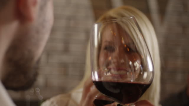 Young Couple Enjoys With Glass of Red Wine 4K slow motion