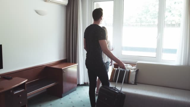 young couple entering the hotel room - guest stock videos & royalty-free footage