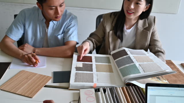 young couple evaluating fabric swatches - color swatch stock videos & royalty-free footage