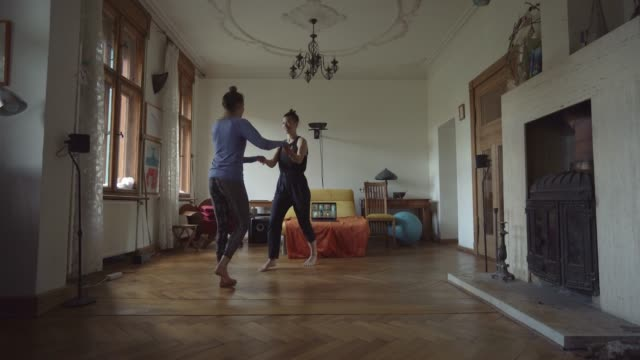 young couple exercising at home together - couple relationship stock videos & royalty-free footage