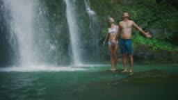 Young couple exploring waterfalls