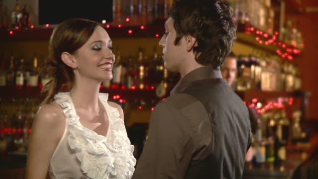 ms young couple flirting in bar, jacksonville, florida, usa - flirten stock-videos und b-roll-filmmaterial