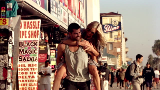 young couple flirting venice beach los angeles. - venice california stock videos & royalty-free footage