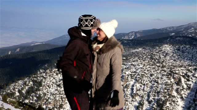 young couple have fun on the top of the mountain,amazing winter ambient - winter sport stock videos & royalty-free footage