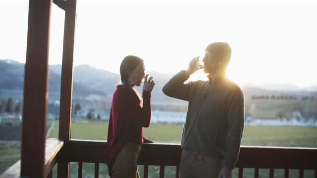 young couple having a drink at sunset - girlfriend stock videos & royalty-free footage