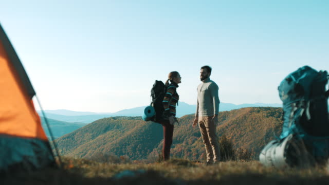 young couple having fight on camping trip at mountain - people standing in a row stock videos & royalty-free footage