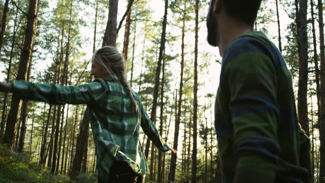 young couple having fun in the forest - simple living stock videos & royalty-free footage