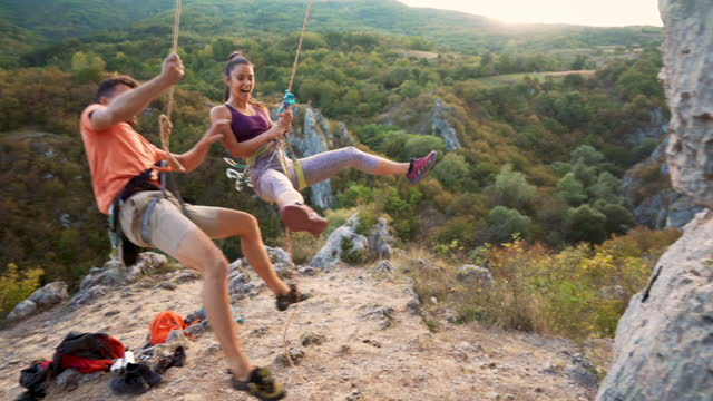 young couple having fun on a climbing day - safety harness stock videos & royalty-free footage
