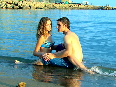 young couple having fun on beach - semi dress stock videos and b-roll footage