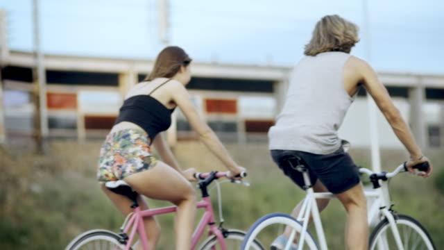 Young couple having fun on bicycleride