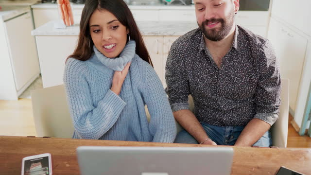 young couple having video call at home, italy - gestikulieren stock-videos und b-roll-filmmaterial