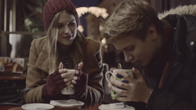 young couple heating with a cup of tea - loving cup stock videos & royalty-free footage