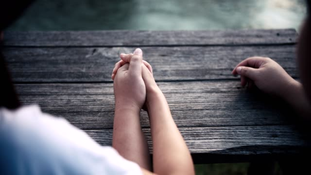 young couple holding hands in park - hands clasped stock videos and b-roll footage