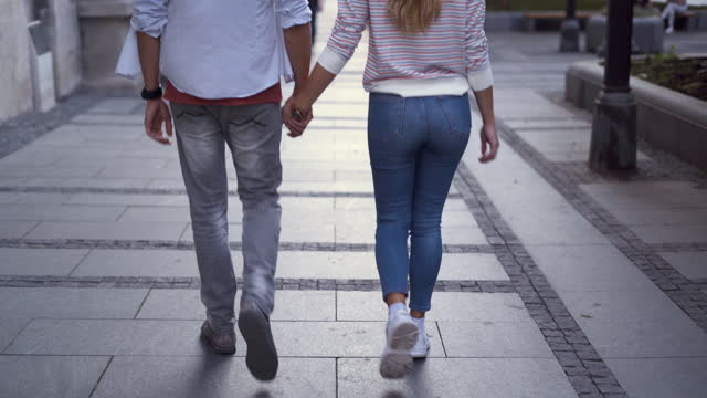 young couple holding hands - falling in love stock videos & royalty-free footage