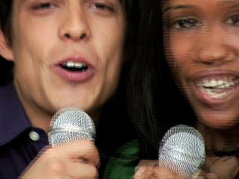 cu young couple holding microphone and singing / new york city, new york, usa - african american culture stock videos & royalty-free footage