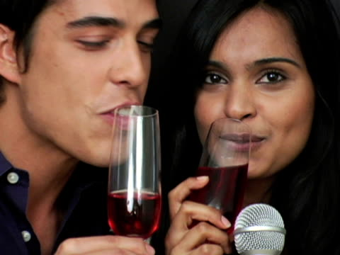 cu young couple holding microphone and toasting with wine / new york city, new york, usa - mid length hair stock videos & royalty-free footage