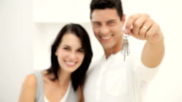 Young Couple Holding New House Keys