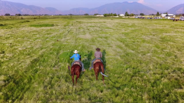 young couple horseback riding - rancher stock videos & royalty-free footage