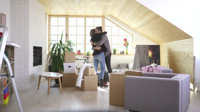 young couple hugging in their new home - tenant stock videos & royalty-free footage