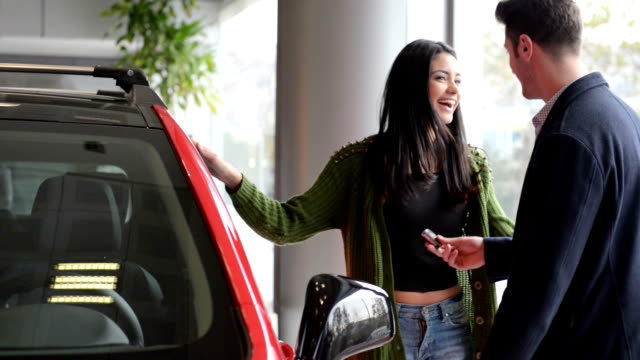 young couple in a car dealership - new stock videos & royalty-free footage