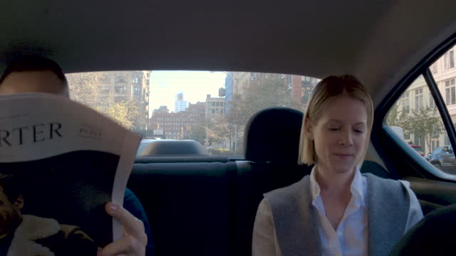 young couple in back seat at car, camera pans left from driver, daytime - passenger seat stock videos and b-roll footage