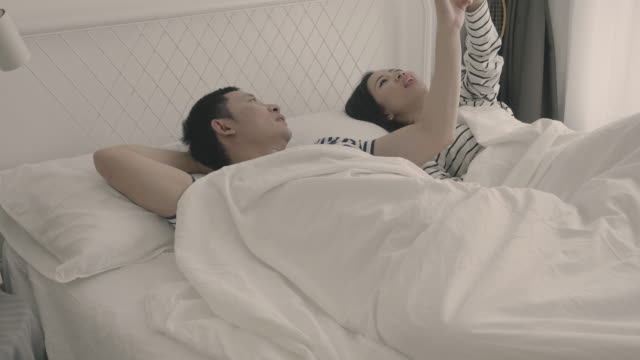 Young couple in bed - Stock video