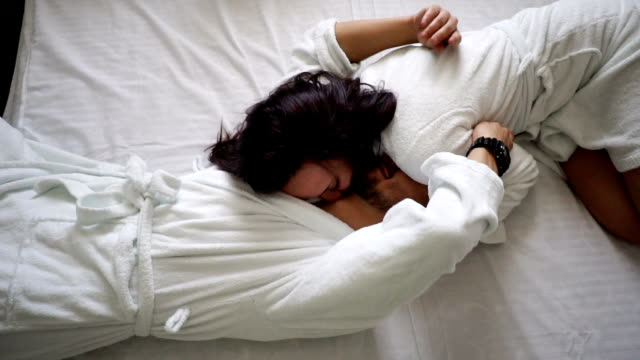 young couple in bed - bathrobe stock videos & royalty-free footage