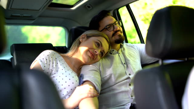young couple in car - car interior stock videos & royalty-free footage