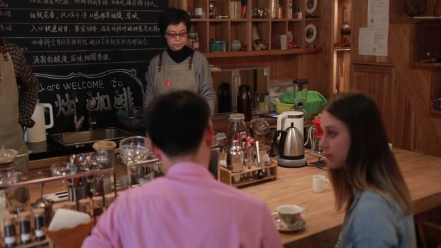 young couple in coffee lab - cafeteria worker stock videos and b-roll footage