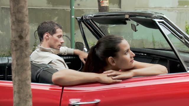 stockvideo's en b-roll-footage met young couple in convertible - passagiersstoel