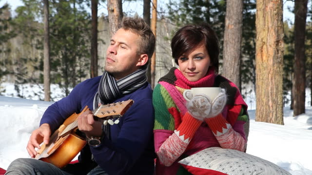 young couple in forest (hd) - mitten stock videos and b-roll footage