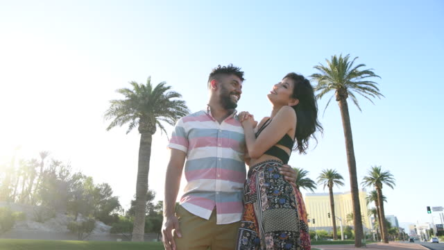 young couple in las vegas walking on boulevard - beautiful woman stock videos & royalty-free footage