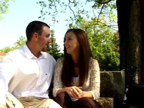 stockvideo's en b-roll-footage met young couple in love at the park - jong van hart
